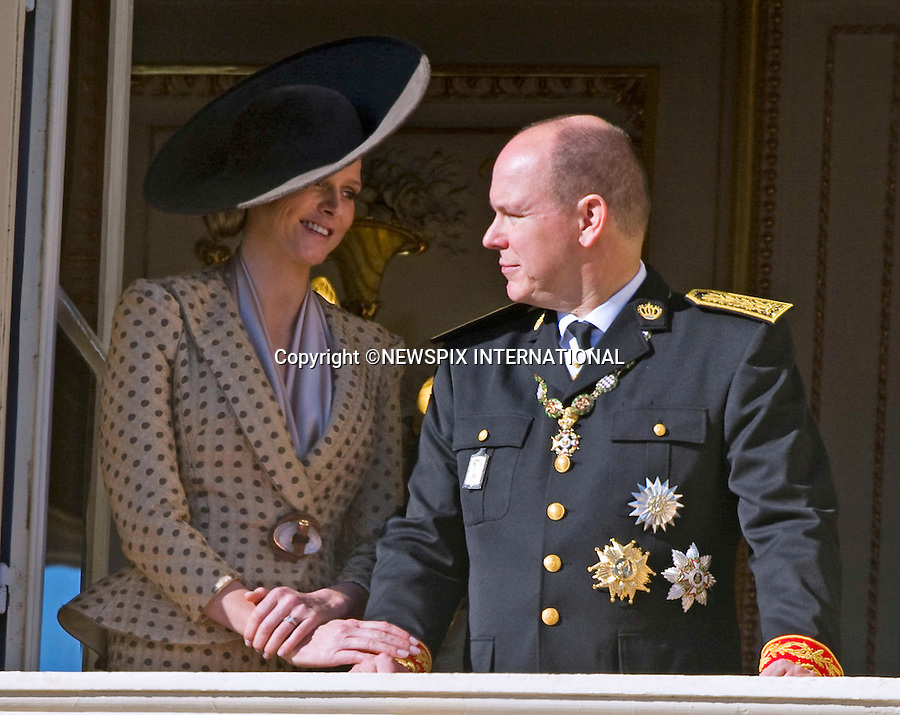 """Charlene Wittstock and Prince Albert II of Monaco_ wearing her engagement ring.MONACO NATIONAL DAY 2010 (Fête Nationale Monégasque 2010).The Royal Family greet the crowds and watch the Army Parade from the balcony of the Prince's palace as part of Monaco's National Day celebrations. Monaco_19/11/2010.Mandatory Photo Credit: ©Dias/Newspix International..**ALL FEES PAYABLE TO: """"NEWSPIX INTERNATIONAL""""**..PHOTO CREDIT MANDATORY!!: NEWSPIX INTERNATIONAL(Failure to credit will incur a surcharge of 100% of reproduction fees)..IMMEDIATE CONFIRMATION OF USAGE REQUIRED:.Newspix International, 31 Chinnery Hill, Bishop's Stortford, ENGLAND CM23 3PS.Tel:+441279 324672  ; Fax: +441279656877.Mobile:  0777568 1153.e-mail: info@newspixinternational.co.uk"""