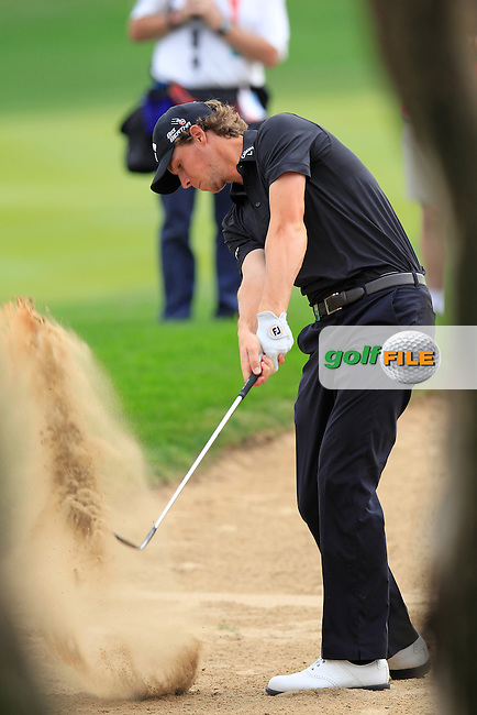 Thomas Pieters (BEL) plays his 2nd shot on the 13th hole during Sunday's Final Round of the Abu Dhabi HSBC Golf Championship 2015 held at the Abu Dhabi Golf Course, United Arab Emirates. 18th January 2015.<br /> Picture: Eoin Clarke www.golffile.ie