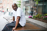 "Marine Corps veteran David Cleckley, age 60, is seen sitting across the street from the New England Center for Homeless Veterans in Boston, Mass., on Tues., June 28, 2016. Cleckley has lived at the NECHV since March 2015. He had been living in Amesbury, Mass., sober for 9 years, but then started using drugs again. He was arrested and placed in prison due to drug-related crimes. After he got out, he lived with his daughter for a month and then moved to the NECHV. He said that the Center has given him somewhere stable, and he feels a sense of camaraderie with the other veterans there. ""The medical staff is beyond great,"" Cleckley said. He is a musician and a cook, and has taken some classes in Culinary Arts through a partnership operated by the NECHV and the Pine Street Inn in Boston. ""I don't know where I'd be [without the NECHV],"" Cleckley said, ""I'd be on the streets."" Cleckley says that within about 3 months, he hopes to leave the NECHV through their housing assistance programs. ""It will all be worth it. You need patience. A lot of people [at NECHV] leave as soon as they open the door."" ""There shouldn't be homeless veterans anywhere,"" he said."