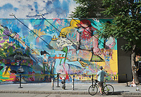 New York, NY 2 June 2016 - Man with a bicycle viewing artist David Choe's mural, at the Houston Bowery Mural. © Stacy Walsh Rosenstock