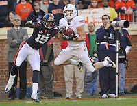 28 November 2009:  Virginia Tech WR Danny Coale (19) catches a pass along the sideline behind Virginia CB Ras-I Dowling (19)..The Virginia Tech Hokies defeated the Virginia Cavaliers 42-13 at Scott Stadium in Charlottesville, VA..