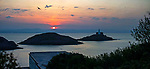 Swansea, UK, 24th April 2020.<br />The sun rises over the Mumbles Lighthouse near Swansea today as government warnings continue to ask people to stay at home due to the Coronavirus outbreak that is spreading across the UK and the world.