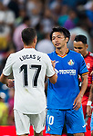 Gaku Shibasaki of Getafe CF shakes hands with Lucas Vazquez of Real Madrid after the La Liga 2018-19 match between Real Madrid and Getafe CF at Estadio Santiago Bernabeu on August 19 2018 in Madrid, Spain. Photo by Diego Souto / Power Sport Images
