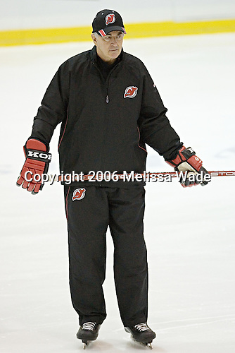 Jacques Caron watches as the players skate laps. The New Jersey Devils and prospects took part in their second official on-ice day of training camp on Saturday, September 16, 2006 at the Richard E. Codey Rink at South Mountain in West Orange, New Jersey.<br />