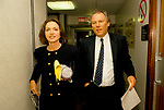 Anna Ford and Peter SissonS, British Television News presenters, walk to the BBC News at 6.00 studio. 1990s UK