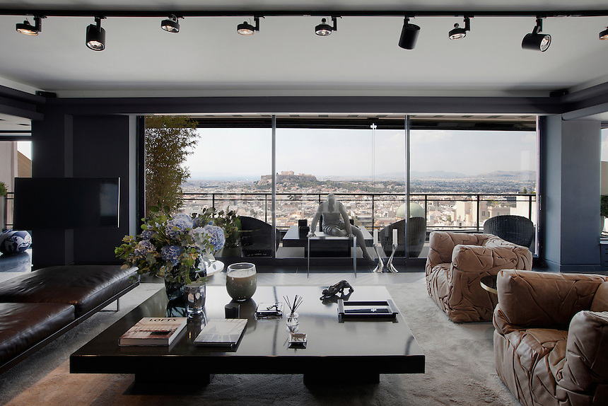 Contemporary living room<br /> <br /> 200 sq. mt. apartment in the posh Kolonaki area of Athens, Greece decorated with furniture from the best of Italian designers and has an outstanding view of the Acropolis.