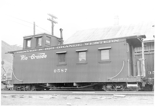Right side of caboose #0587.<br /> D&amp;RGW  Durango, CO  Taken by Payne, Andy M. - 4/27/1958