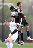 Andy Najar (14) and Cristian Quinones (37) of D.C. United out jump Will Bates (10)  during a scrimmage against the University of Virginia at Ludwig Field, University of Maryland, College Park, on April  10 2011. D.C. United won 1-0.