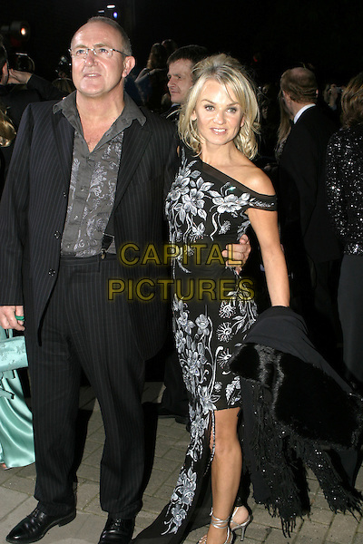 LISA MAXWELL.National Television Awards, Royal Albert Hall..October 26th, 2004.full length, floral print off the shoulder dress, pinstripes.www.capitalpictures.com.sales@capitalpictures.com.© Capital Pictures.