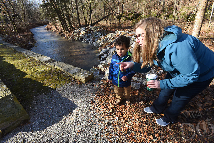 NWA Democrat-Gazette/FLIP PUTTHOFF <br /> CREEKSIDE TRAIL<br /> Elizabeth Willett of Rogers and her son, Langston Murchison, 3, play beside Little Clifty Creek on Saturday Jan. 5 2019 while exploring the Historic Van Winkle Trail at Hobbs State Park-Conservation Area east of Rogers. Most trails at the park are closed today for the final day of a youth deer hunt. Historic Van Winkle and Ozark Plateau trails, both near the visitor center, are open. The park's shooting range is closed today. At 12,000 acres, Hobbs is the only Arkansas state park where hunting is allowed.