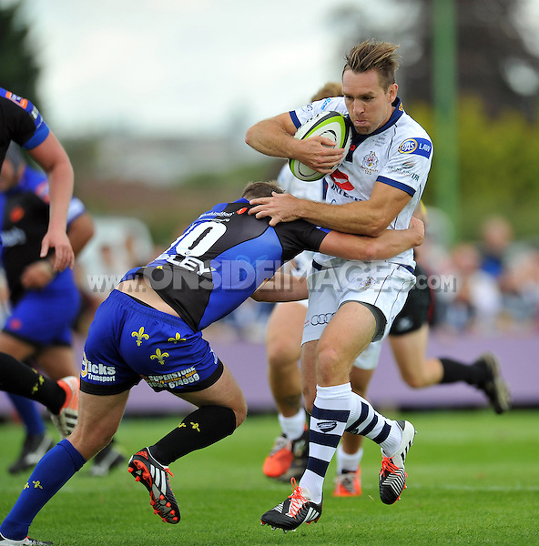 Adrian Jarvis is tackled in possession. Pre-season friendly match, between Bristol Rugby and Newport Gwent Dragons on August 17, 2014 at the Cribbs Causeway Ground in Bristol, England. Photo by: Patrick Khachfe / JMP