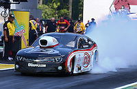 Jun. 2, 2013; Englishtown, NJ, USA: NHRA pro mod driver Rickie Smith during the Summer Nationals at Raceway Park. Mandatory Credit: Mark J. Rebilas-