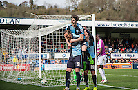 Max Kretzschmar of Wycombe Wanderers leaps on Goal scorer Paul Hayes of Wycombe Wanderers to celebrate during the Sky Bet League 2 match between Wycombe Wanderers and Barnet at Adams Park, High Wycombe, England on 16 April 2016. Photo by Kevin Prescod.