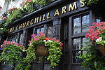 Exterior of Churchill Arms pub in Notting Hill, London
