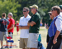 Mizzou Cross Country and distance coach Joe Lynn watches the action at the 2013 Forest Park Cross Country Festival.