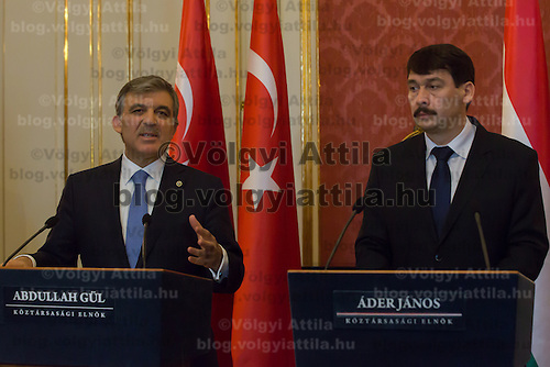 Abdullah Gul (L) president of Turkey and his Hungarian counterpart Janos Ader (R) talk on a press conference during their meeting in Budapest, Hungary on February 17, 2014. ATTILA VOLGYI