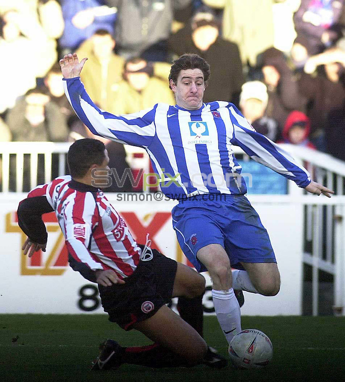 Pics: Chris Whiteoak/SWpix: Football, FA Cup 4th Round replay, Hartlepool v Brentford. 12/2/05..Hartlepool's Joel Porter is tackled by Brentford's John Salako