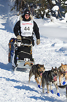 Aaron Burmeister on Long Lake at the Re-Start of the 2012 Iditarod Sled Dog Race