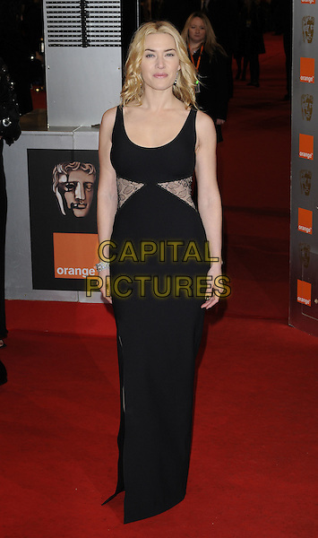 KATE WINSLET.Arrivals at the Orange British Academy Film Awards 2010 at the Royal Opera House, Covent Garden, London, England..February 21st, 2010.BAFTA BAFTAs full length black sleeveless lace insert sides dress panel panels maxi .CAP/CAN.©Can Nguyen/Capital Pictures.