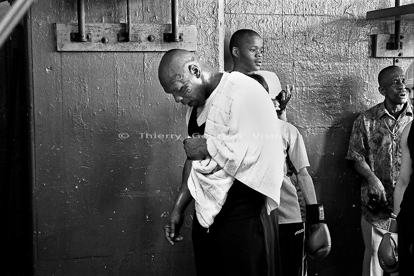 Mike Tyson at Gleason's Gym to train young local boxers. Tyson agreed to 100 hours of community service, training young boxers, as part of a plea deal agreement to avoid assault charges. Brooklyn , New York March 11, 2004. Photo by Thierry Gourjon