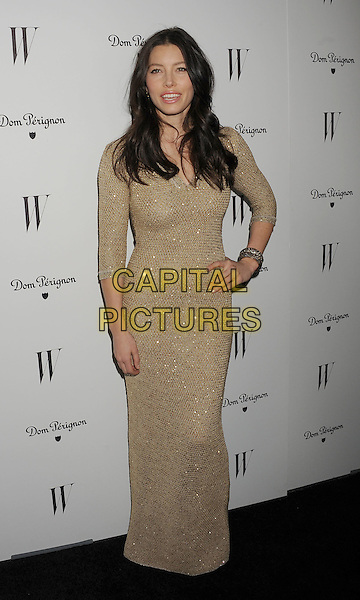 Jessica Biel.W Magazine's 69th Annual Golden Globe Awards Celebration held at The Chateau Marmont, West Hollywood, California, USA..13th January 2012.full length dress gold long sleeves hand on hip beige shiny nude  bracelets .CAP/ROT/TM.©Tony Michaels/Roth Stock/Capital Pictures
