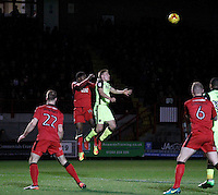 Exeter City's David Wheeler competes with Crawley Town's Andre Blackman for the header during the Sky Bet League 2 match between Crawley Town and Exeter City at Broadfield Stadium, Crawley, England on 28 February 2017. Photo by Carlton Myrie / PRiME Media Images.