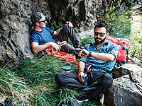 Owner of Rocky Mountain Slackline Dakota Collins (left), with The Adventurist columnist, Clint Carter at at North Tale Mountain in Golden, Colorado, Tuesday, August 29, 2017. Carter take on a vertigo-inducing highline that stretches across a traverse after only 4 days of training.<br /> <br /> Photo by Matt Nager