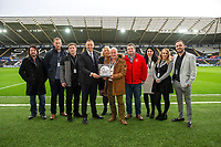 Lee Trundle with the match ball sponsors during the Sky Bet Championship match between Swansea City and Middlesbrough at the Liberty Stadium in Swansea, Wales, UK. Saturday 14 December 2019