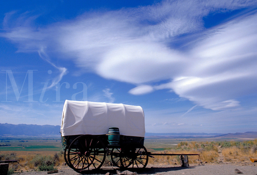Western scene. A modern recreation of a covered wagon illustrates the means of transportation used during transit along the Oregon Trail. Seen near Baker City. Baker City Oregon, Oregon Trail.