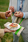 USA, Tennessee, Nashville, Iroquois Steeplechase, eating Mini Berry Pies with lattice crust