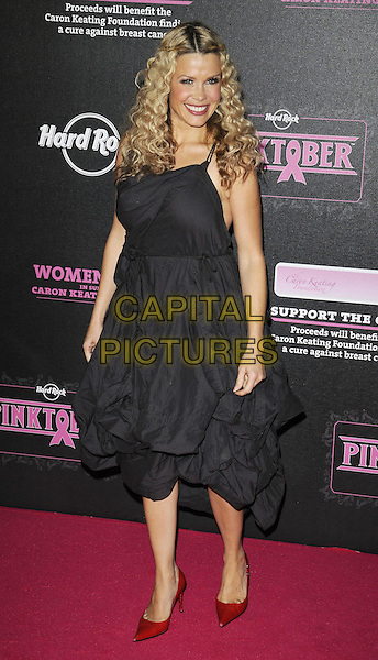 MELINDA MESSENGER .attending the Pinktober Women of Rock Charity Concert, Royal Albert Hall, London, England, UK,.1st November 2009..full length black dress  ruched red pointy shoes gathered .CAP/CAN.©Can Nguyen/Capital Pictures.