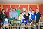 Sean Marshall Fund Draw: J.P Twoomey, Chairman, Fundraising Committee, Drawing the winning ticket in the draw held at Parkers Pub, Kilflynn on Friday night last, Front: Caro;ine Corkery, J.P. Twoomey, Josh Leahy, Betty Falvey, Greg Leahy & Declan Falvey. Back: John Leahy, Ml. Parkrt, Joe Flynn, Annette Nolan & Nicholas Scollard.