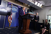United States President Donald J. Trump speaks during a news conference at the White House in Washington D.C., U.S. on Monday, April 20, 2020.  US Vice President Mike Pence looks on.<br /> Credit: Tasos Katopodis / Pool via CNP