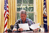United States President Bill Clinton delivers his weekly radio address from the Oval Office of the White House in Washington, DC on June 11, 1994.<br /> Credit: White House via CNP