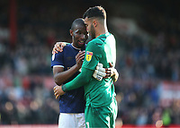 Kamohelo Mokotjo of Brentford embraces goalkeeper David Raya at the final whistle as they celebrate their victory during Brentford vs Millwall, Sky Bet EFL Championship Football at Griffin Park on 19th October 2019