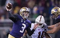 Jake Browning fires a pass in the first half.