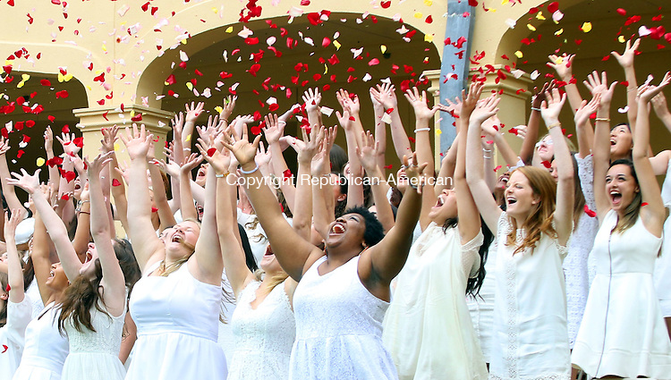 MIDDLEBURY CT. 03 June 2016-060316SV04-Graduates toss rose petals into the air after receiving their diplomas during the Westover School graduation in Middlebury Friday.<br /> Steven Valenti Republican-American