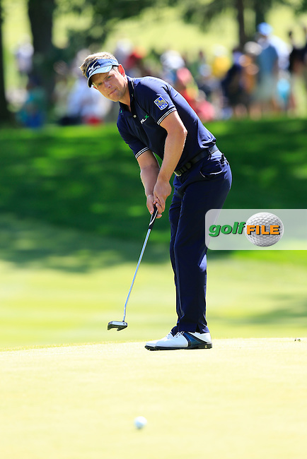 Luke Donald (ENG) putts on the 9th green during Sunday's Final Round of the 2013 Bridgestone Invitational WGC tournament held at the Firestone Country Club, Akron, Ohio. 4th August 2013.<br /> Picture: Eoin Clarke www.golffile.ie
