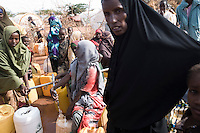 Kenya - Dadaab - Somali women queuing at the water well at Ifo camp.