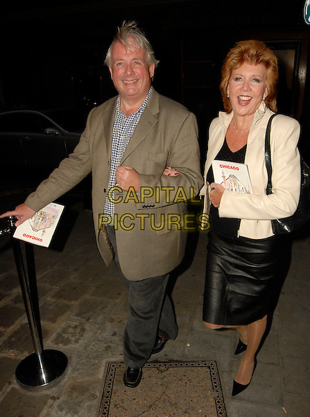 CHRISTOPHER BIGGINS & CILLA BLACK.The Chicago: The Musical - celebrity party at The Cambridge Theatre, London, UK.May 2nd, 2006 .Ref: SW.full length black leather skirt brown suit jacket.www.capitalpictures.com.sales@capitalpictures.com.©Capital Pictures.