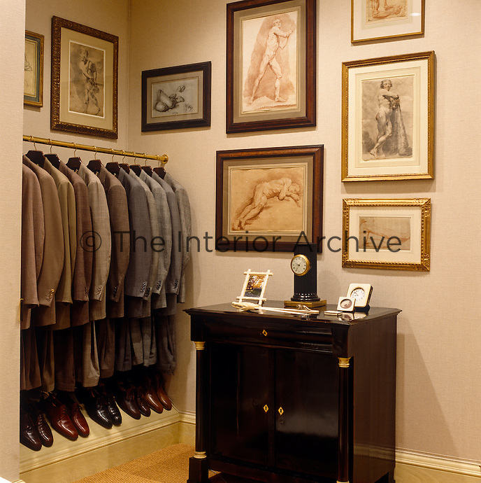 The walls of this dressing room are lined with a collection of drawings and rows of suits are colour-matched with pairs of shoes