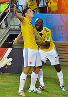 CUIABA - BRASIL -24-06-2014. James Rodriguez (#10) y Pablo Armero (#7) jugadores de Colombia (COL) celebra un gol anotado a Japón (JPN) durante partido del Grupo C de la Copa Mundial de la FIFA Brasil 2014 jugado en el estadio Arena Pantanal de Cuiaba./ James Rodriguez (#10) and Pablo Armero (#7) players of Colombia (COL) celebrate a goal scored to Japan (JPN) during the macth of the Group C of the 2014 FIFA World Cup Brazil played at Arena Pantanal stadium in Cuiaba. Photo: VizzorImage / Alfredo Gutiérrez / Contribuidor