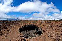 Large skylight along the access road to Mauna Loa volcano 13679' Mauna Kea in the distance the Big Island of Hawaii