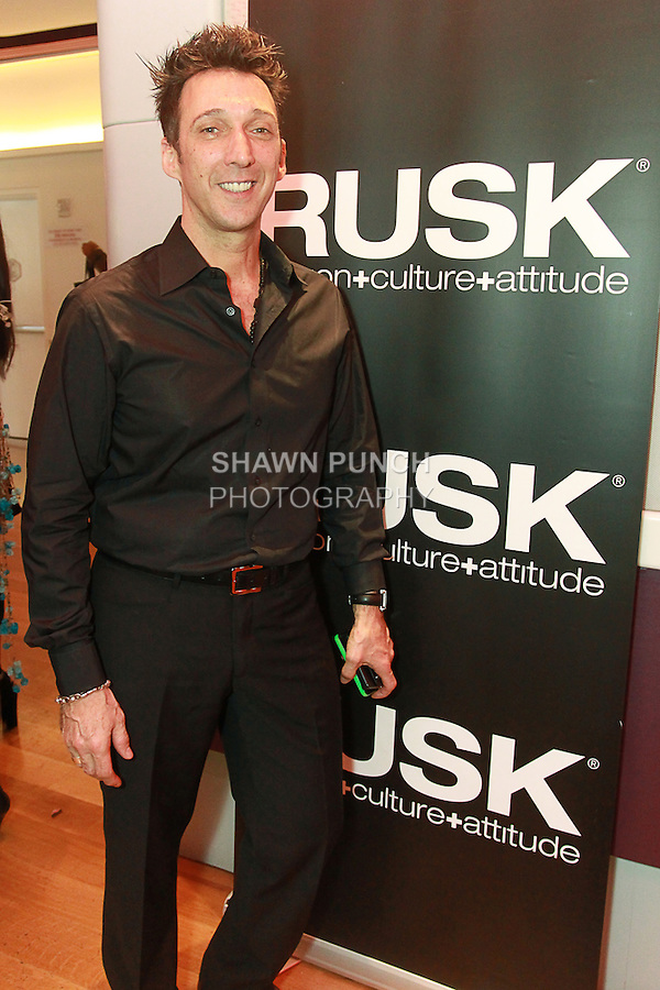 RUSK Artistic Director Gerard Caruso posing at the Nolcha Fashion Lounge + Media Brunch event at the Yotel Hotel, during Nolcha Fashion Week New York Fall 2013, February 14, 2013.