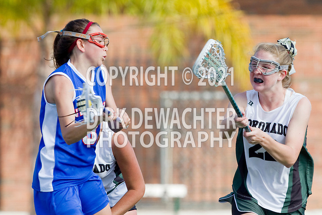 San Diego, CA 04/19/10 - Heidi Halsted (St. Ignatius #9) and Rachel Brennan (Coronado #22) in action during the St Ignatius-Coronado game.