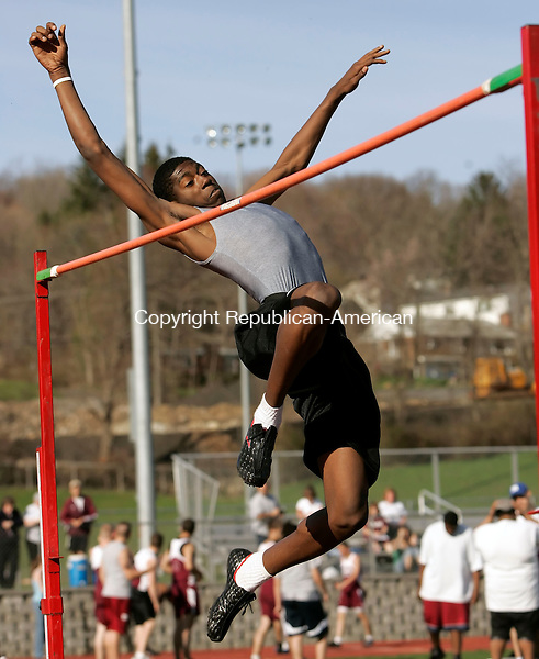 NAUGATUCK, CT 4/24/07- 042407BZ15-  Wilby's Marcus James makes a high jump attempt at a height of 6 feet 6 inches Tuesday.  He won the event with a jump of 6 feet 2 inches then successfully cleared 6 feet 4 inches on his first attempt.<br /> Jamison C. Bazinet Republican-American