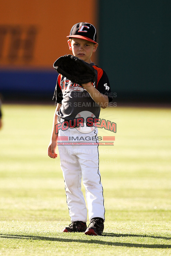 A young fan tosses a ball around prior to a game between the Arkansas Travelers and the Springfield Cardinals at Hammons Field on June 12, 2012 in Springfield, Missouri. (David Welker/Four Seam Images).