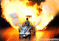 Mar. 8, 2008; Bakersfield, CA, USA; Nostalgia top fuel dragster driver Mike McLennan explodes an engine during qualifying for the 50th annual March Meet at the Auto Club Famoso Raceway. Mandatory Credit: Mark J. Rebilas-US PRESSWIRE