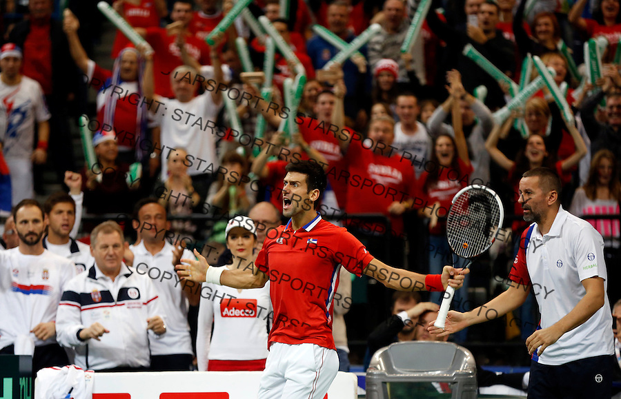 BELGRADE, SERBIA - NOVEMBER 17: Novak Djokovic of Serbia celebrate winning the first set during the mens singles match between Novak Djokovic of Serbia and Tomas Berdych of Czech Republic on day three of the Davis Cup World Group Final between Serbia and Czech Republic at Kombank Arena on November 17, 2013 in Belgrade, Serbia. (Photo by Srdjan Stevanovic/Getty Images)
