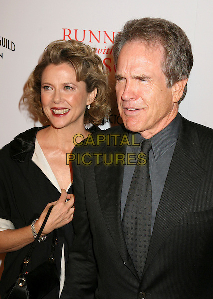 "ANNETTE BENING & WARREN BEATTY.World Premiere of ""Running With Scissors"", Beverly Hills, California, USA..October 10th, 2006.Ref: ADM/BP.half length black jacket married husband wife holding hands.www.capitalpictures.com.sales@capitalpictures.com.©Byron Purvis/AdMedia/Capital Pictures."